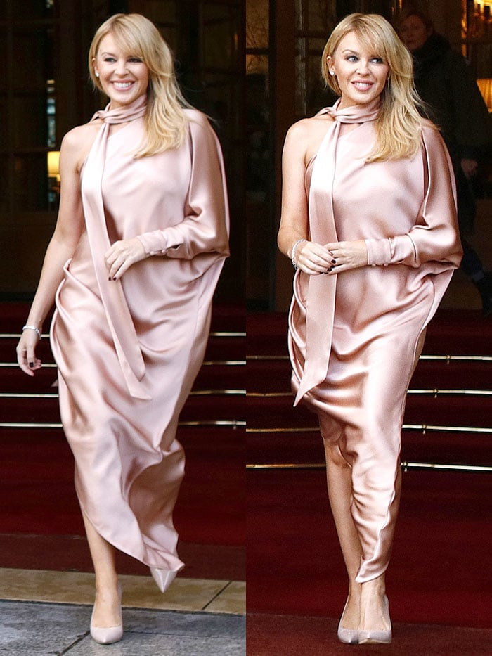 "Kylie Minogue matched her frock's blush-pink hue with nude-tone Ralph & Russo ""Empire"" metal-heel pointed-toe pumps"