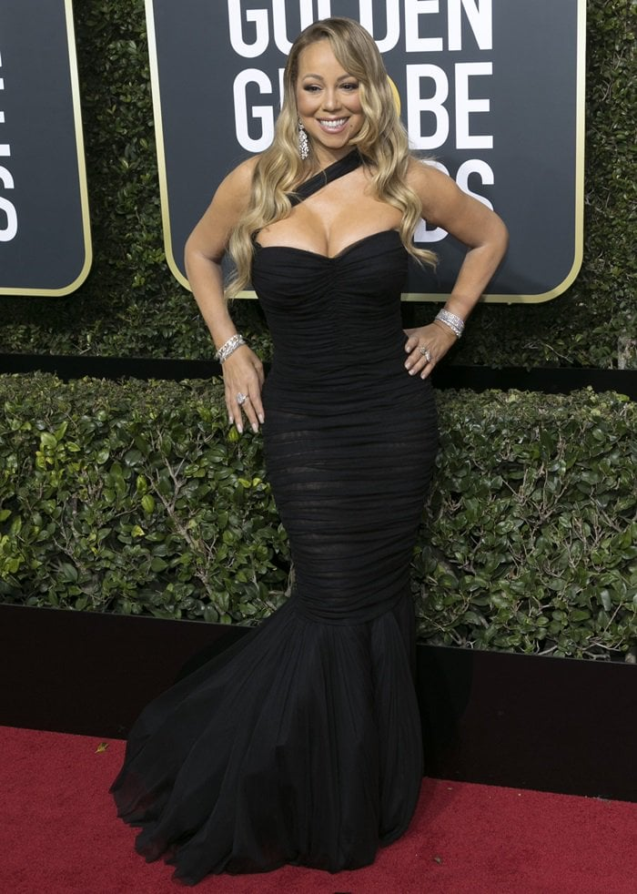 Mariah Carey in a black form-fitting Dolce & Gabbana dress at the 2018 Golden Globe Awards held at the Beverly Hilton Hotel in Beverly Hills, California, on January 7, 2018
