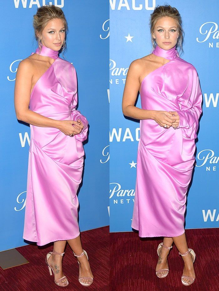 Melissa Benoist completed her look with a messy updo, hoop earrings and blush velvet ankle-strap sandals