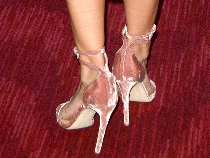 Closeup of Melissa Benoist's blush-pink velvet ankle-strap sandals.