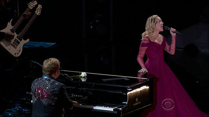 """Miley Cyrus taking the stage with Sir Elton John to perform his classic hit song, 'Tiny Dancer,"""" at the 2018 Grammy Awards held at Madison Square Garden in New York City on January 28, 2018."""