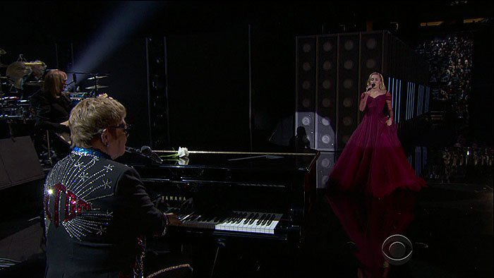 "Miley Cyrus taking the stage with Sir Elton John to perform his classic hit song, 'Tiny Dancer,"" at the 2018 Grammy Awards held at Madison Square Garden in New York City on January 28, 2018."