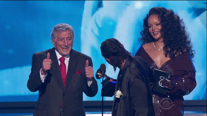 Rihanna and Kendrick Lamar accepting their Best Rap/Sung Performance award from Tony Bennett at the 2018 Grammy Awards.
