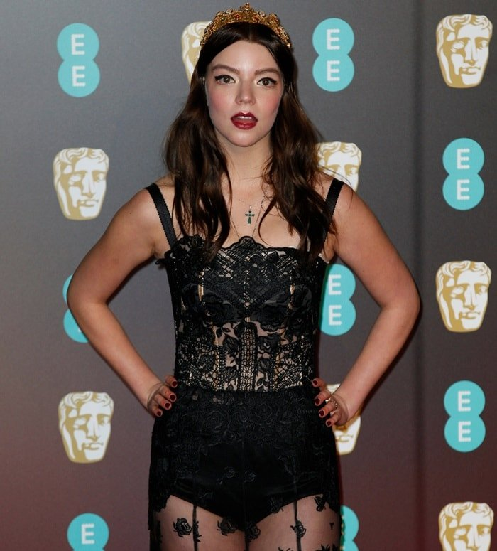 Anya Taylor-Joy did not leave much to the imagination in a sheer black lace embroidered dress from Dolce & Gabbana's Spring 2018 collection