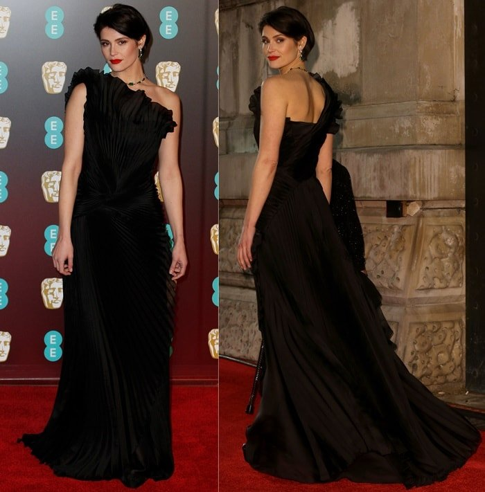 Gemma Arterton in a dark pleated Alberta Ferretti Spring 2018 Couture gown at the 2018 EE British Academy Film Awards held at Royal Albert Hall in London, England, on February 18, 2018