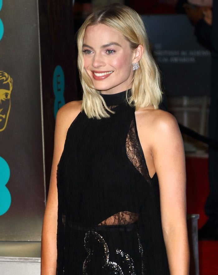 Margot Robbie wearing a black Givenchy gown at the 2018 EE British Academy Film Awards held at Royal Albert Hall in London, England, on February 18, 2018