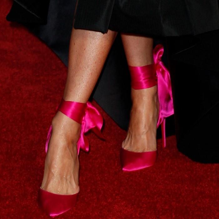 "Tatiana Korsakova wearing pinkChristian Louboutin's ""Douce Du Desert"" pumps"