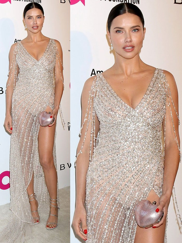 Adriana Lima exposing Spanx and nipples in a Georges Hobeika sheer dress and Rene Caovilla coil sandals.
