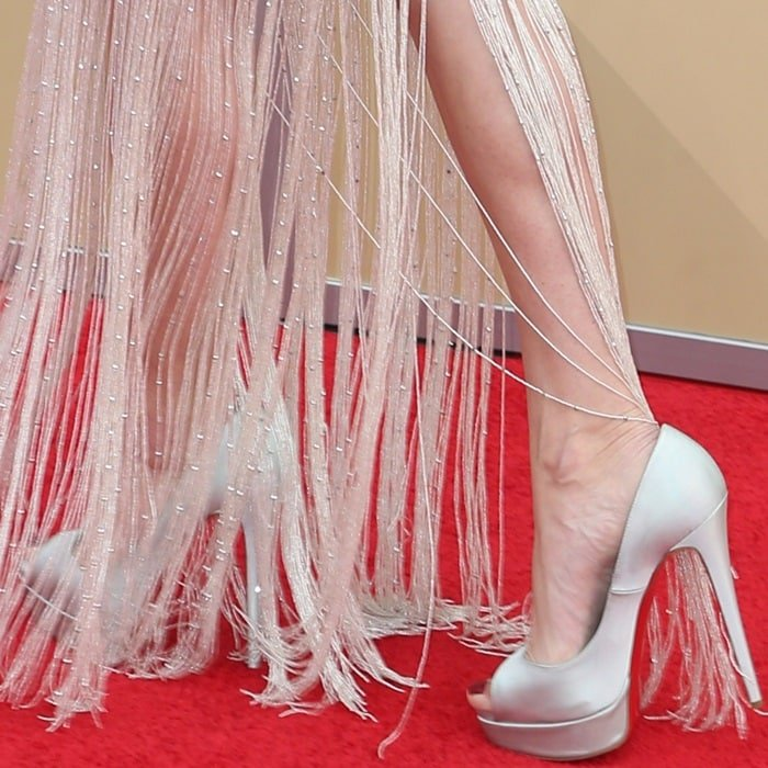 Allison Williams's pedicured toes in Christian Louboutin pumps