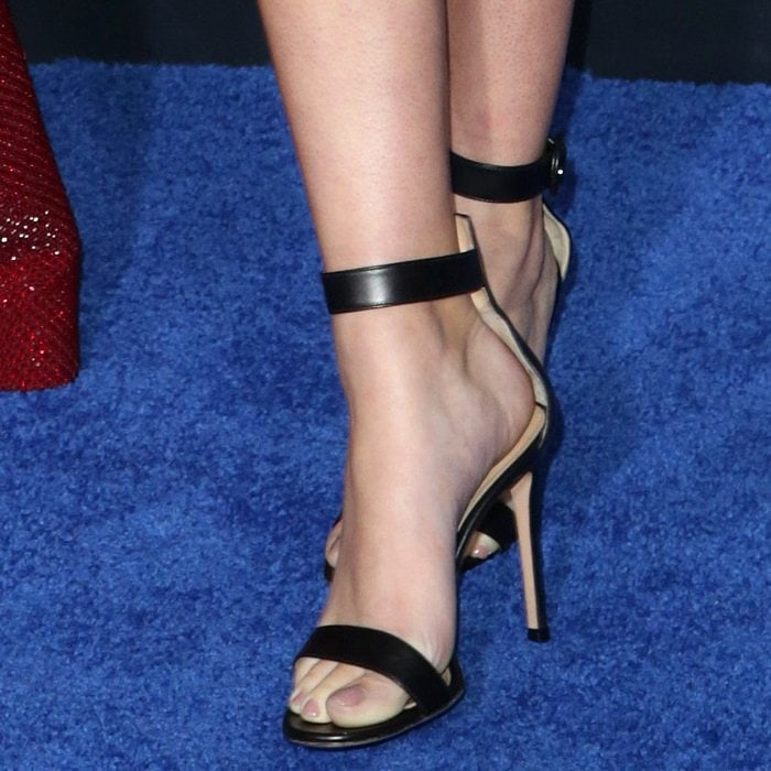 Ava Phillippe's feet in black ankle-strap sandals