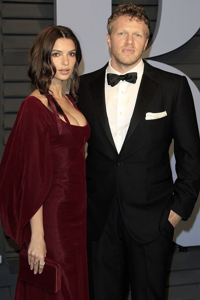 Emily Ratajkowski and new husband Sebastian Bear-McClard posing together at the 2018 Vanity Fair Oscar Party