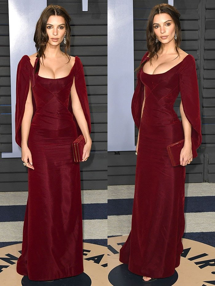 "Emily Ratajkowski in a Zac Posen wine-red caped gown and Stuart Weitzman black-suede ""Nudist"" sandals"