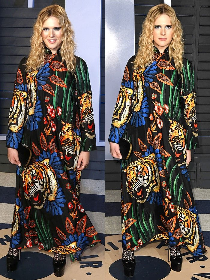 Transgender model Hari Nef in a Gucci tiger-head-print dress and black platforms.