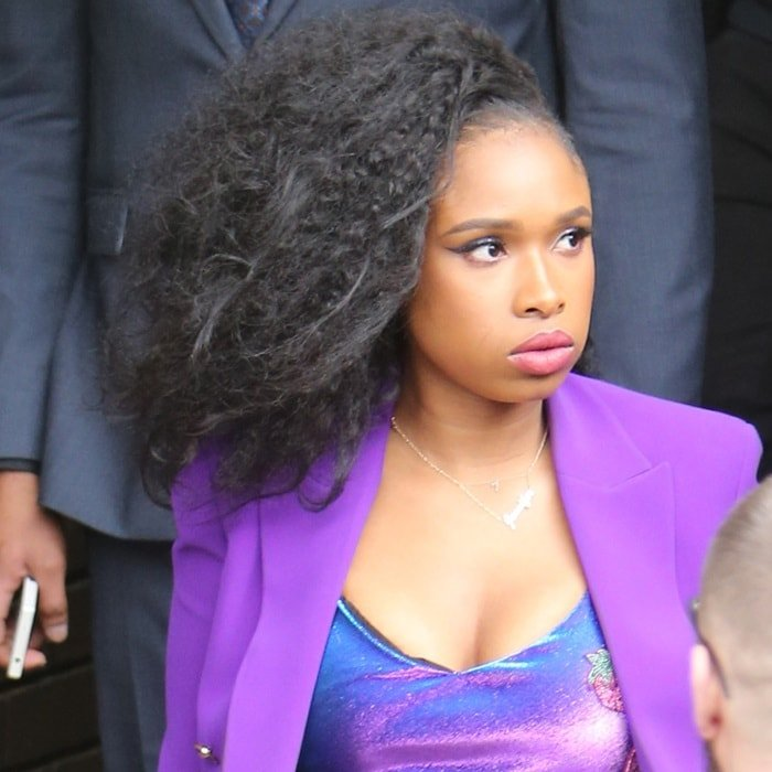 Jennifer Hudson styled her curled black hair into a wild one-sided look