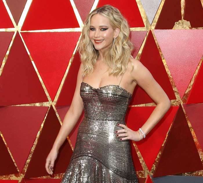 Jennifer Lawrence in a shiny Christian Dior Pre-Fall 2018 gown
