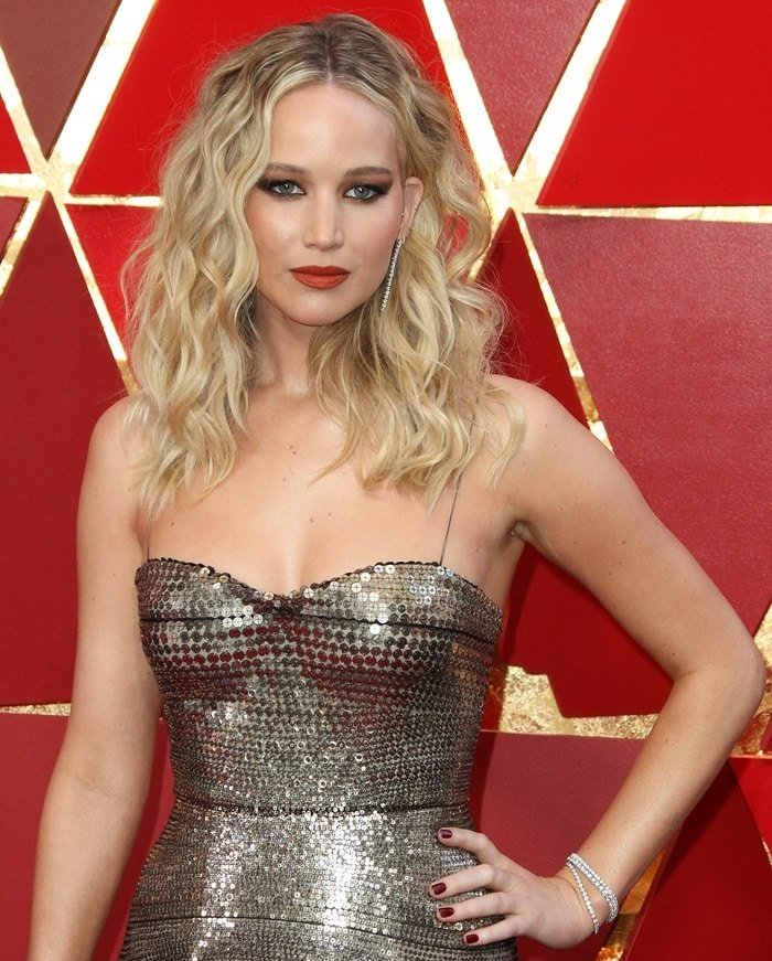 Jennifer Lawrence styled her blonde tresses in waves