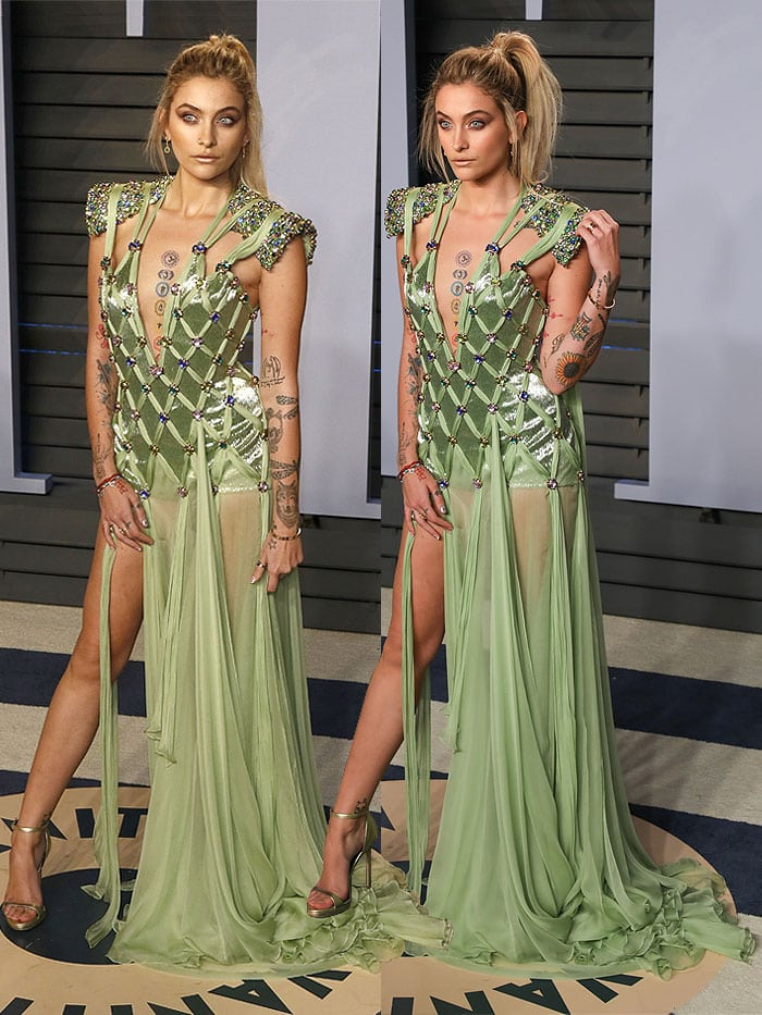 Paris Jackson in an Atelier Versace green knotted dress and Versace ankle-strap sandals at the 2018 Vanity Fair Oscar Party.