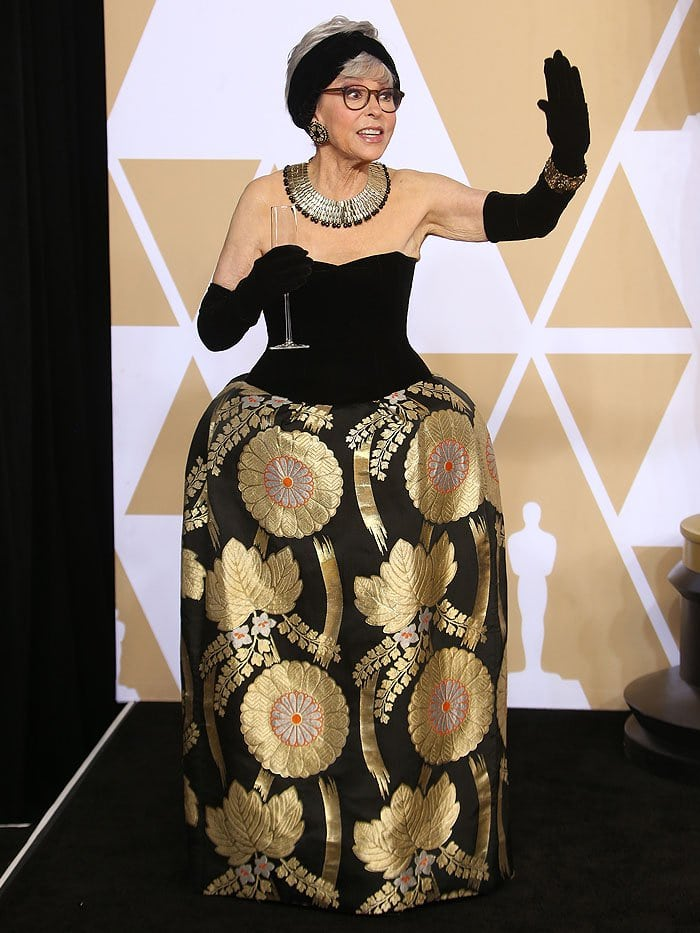 Rita Moreno wearing the same gown she wore to the 1962 Oscars.