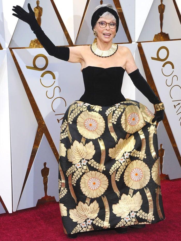 Rita Moreno rewearing her 1962 Oscars gown.