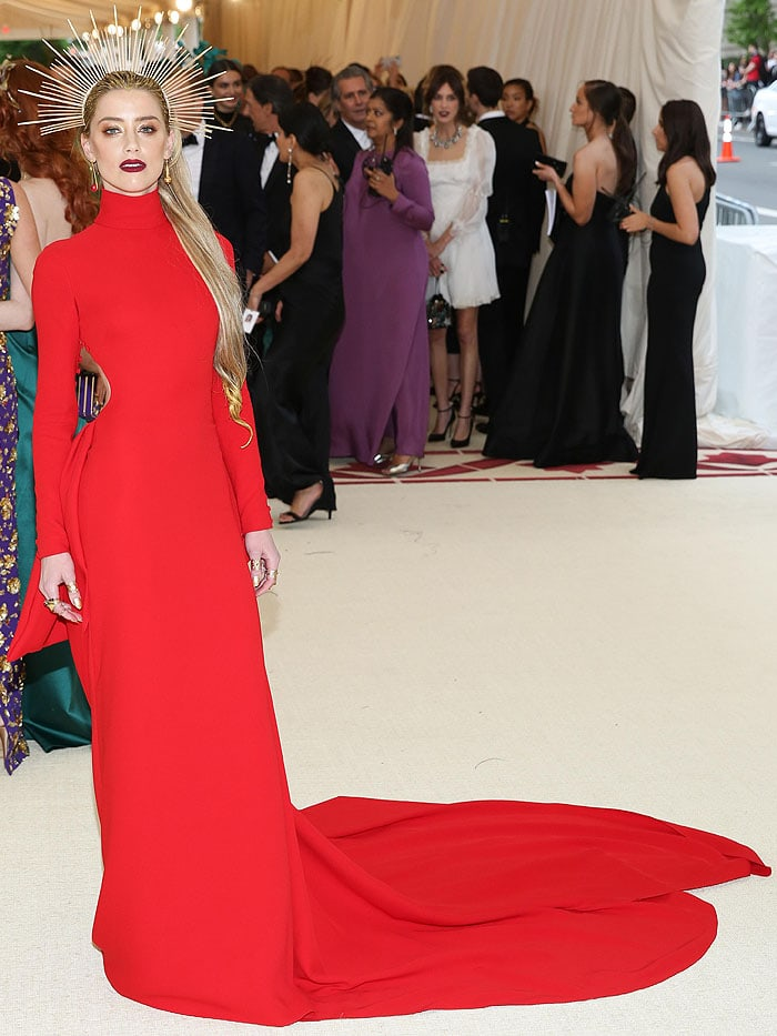 Amber Heard in a Carolina Herrera red long-sleeved gown and an Apatico zip-tie halo.
