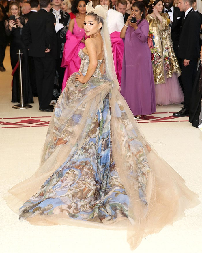 Back view of Ariana Grande's Vera Wang Sistine Chapel strapless ball gown and ribboned horsehair headpiece.
