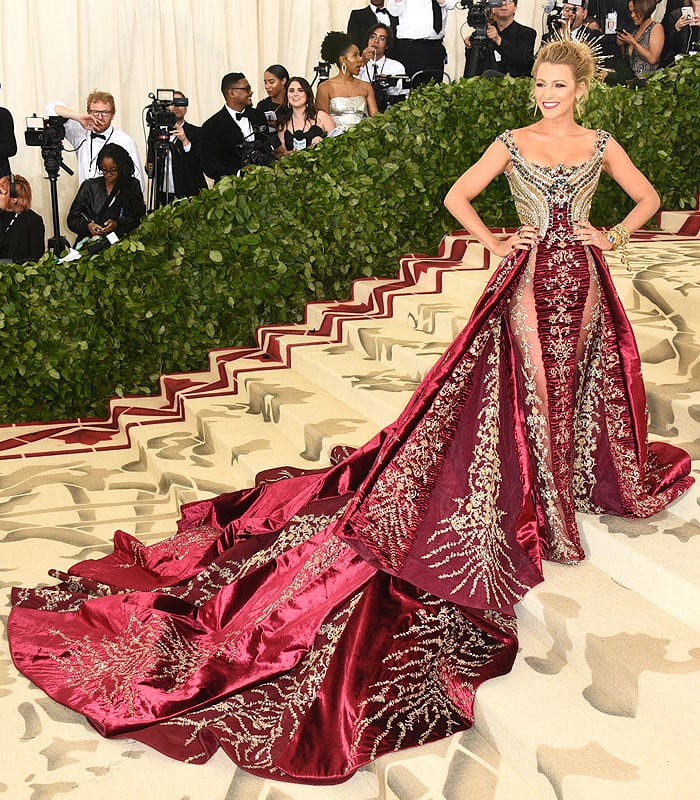 Blake Lively in Atelier Versace ruby-red-and-gold embellished gown and custom Christian Louboutin heels.