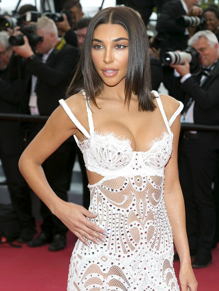 Chantel Jeffries in a sheer, white mesh-and-lace dress