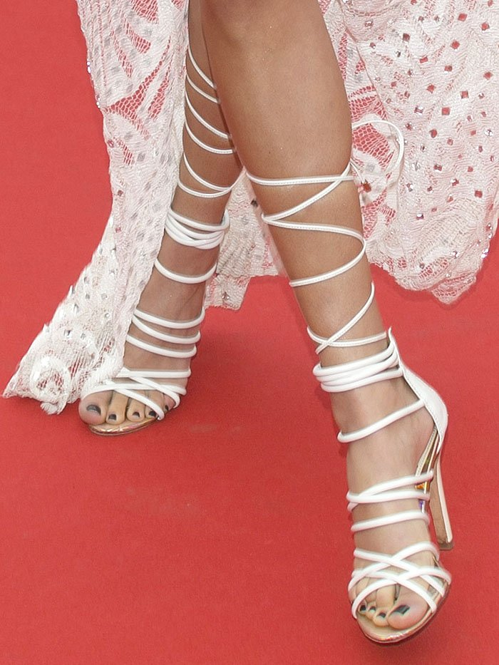 Details of Chantel Jeffries' white lace-up sandals.