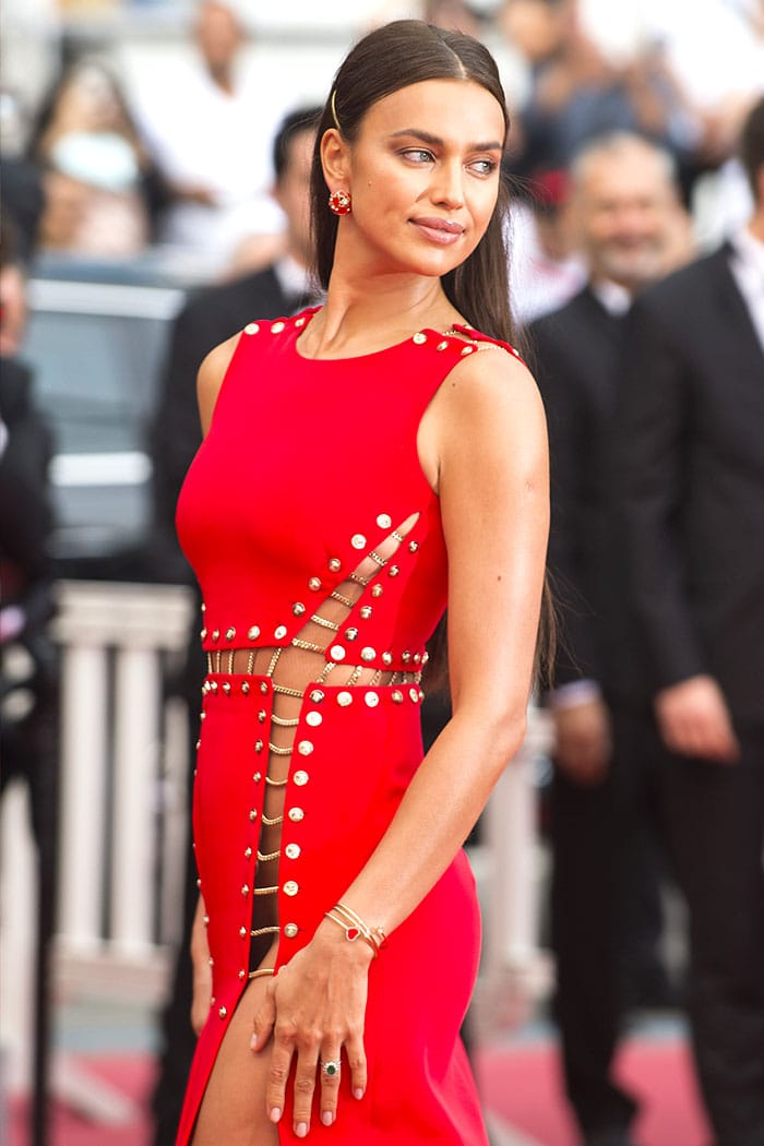 Irina Shayk commando in a red Atelier Versace chained double-split dress.
