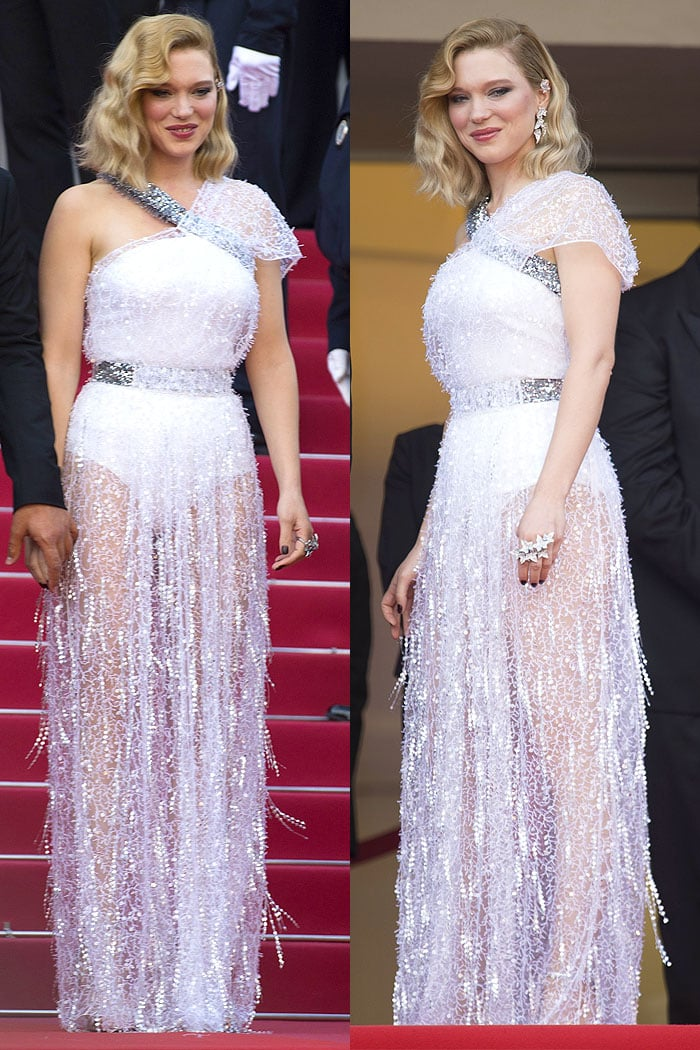 Lea Seydoux in a custom Louis Vuitton tinsel-embellished white-silk gown and Louis Vuitton silver ankle-strap sandals.