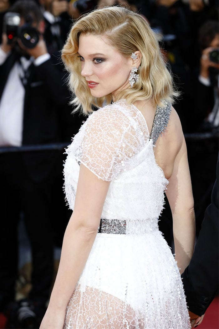 Lea Seydoux baring buttcheeks in a white Louis Vuitton gown.