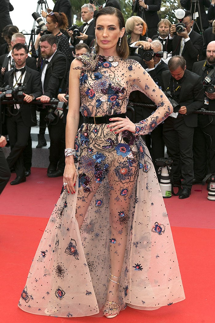 Nieves Alvarez in an Elie Saab Fall 2016 Couture sheer embellished gown and Rene Caovilla crystal-snake sandals.