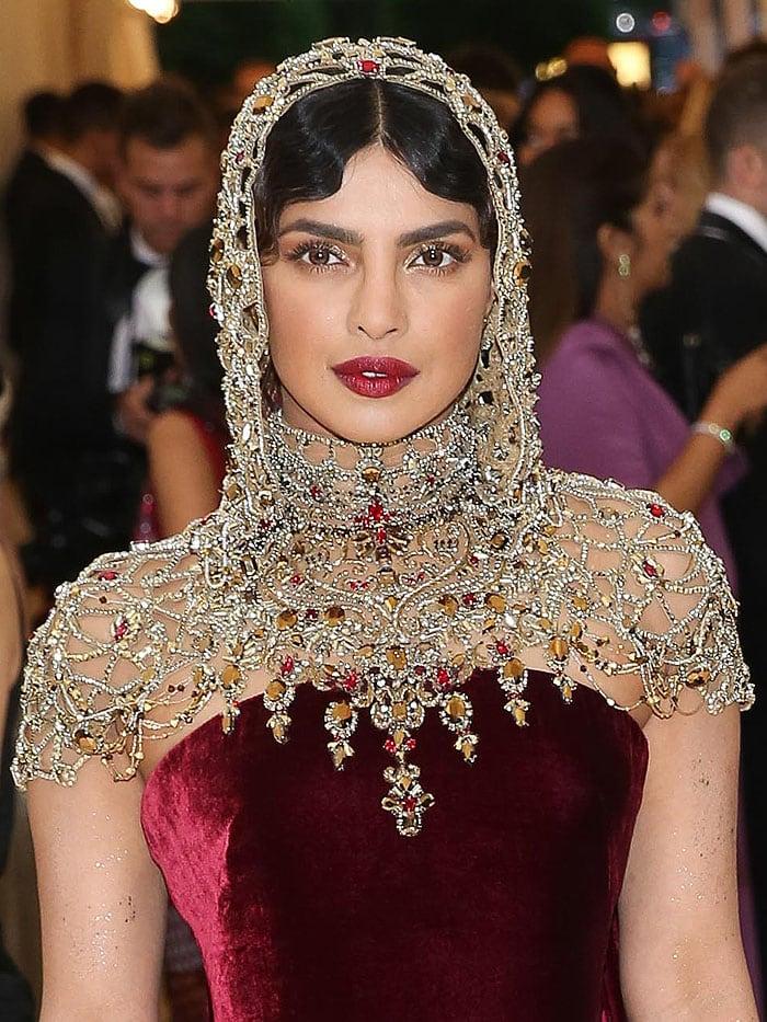 Priyanka Chopra wearing a jeweled hooded headpiece.