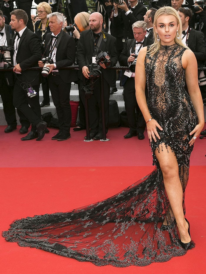 Tallia Storm in a sheer black-lace gown and Saint Laurent 'Opium' pumps.