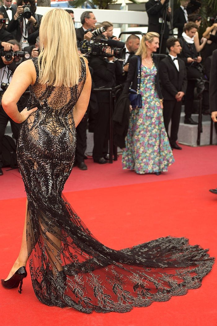 Tallia Storm in a Jean-Paul Benielli Couture sheer black-lace gown and Saint Laurent 'Opium' pumps.