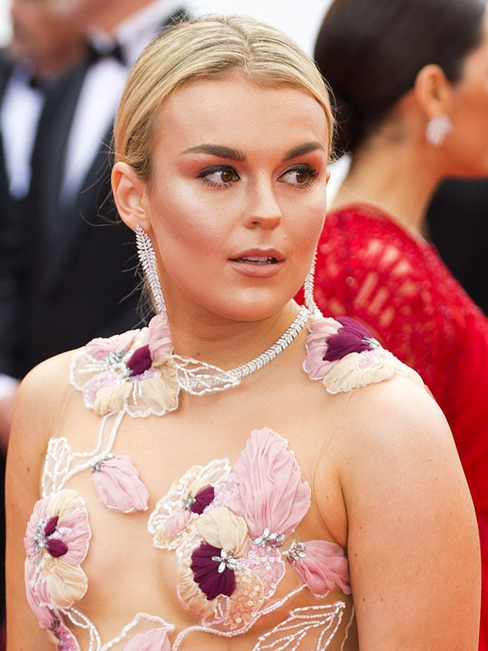 Tallia Storm in a floral embroidered gown with a sheer bodice.