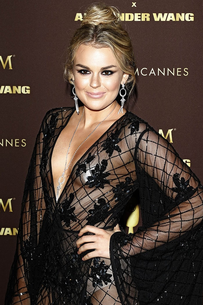 Tallia Storm showing nipple tape and nude underwear under a sheer black robe gown.