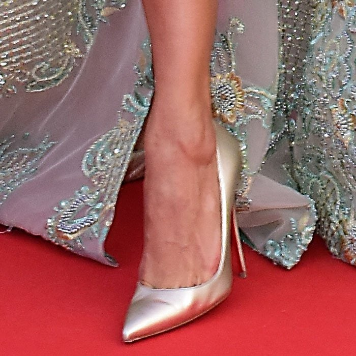 Closeup of the gold Christian Louboutin pumps on Victoria Bonya.