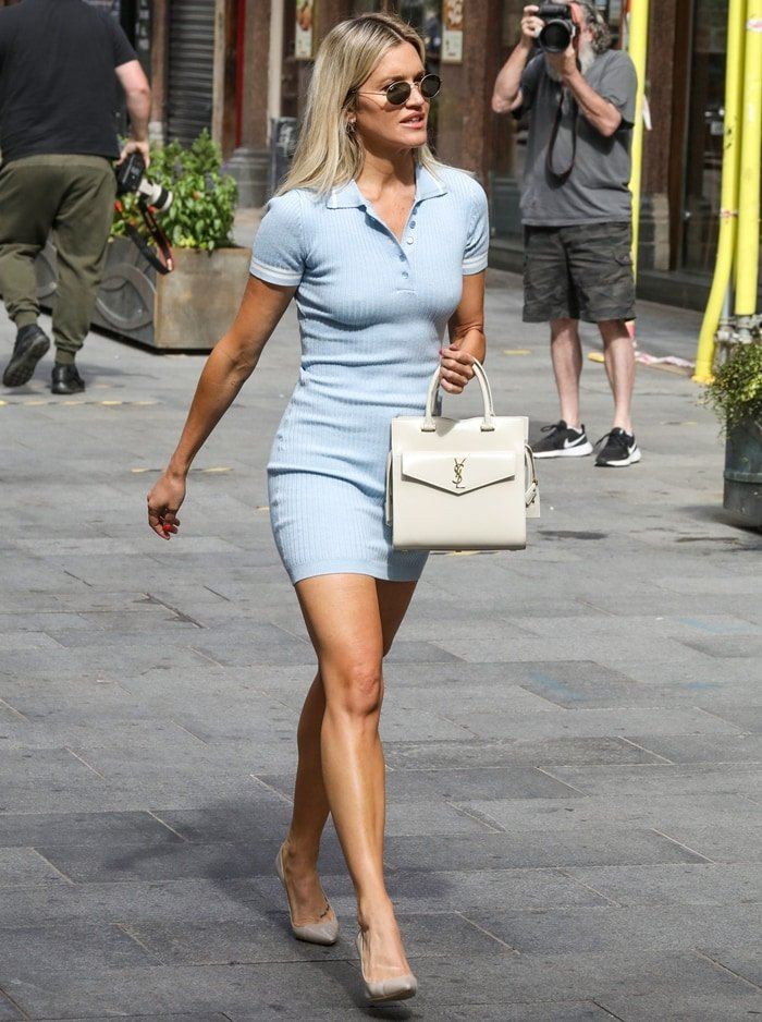 Ashley Roberts flaunts her legs in a pastel blue tennis-style dress