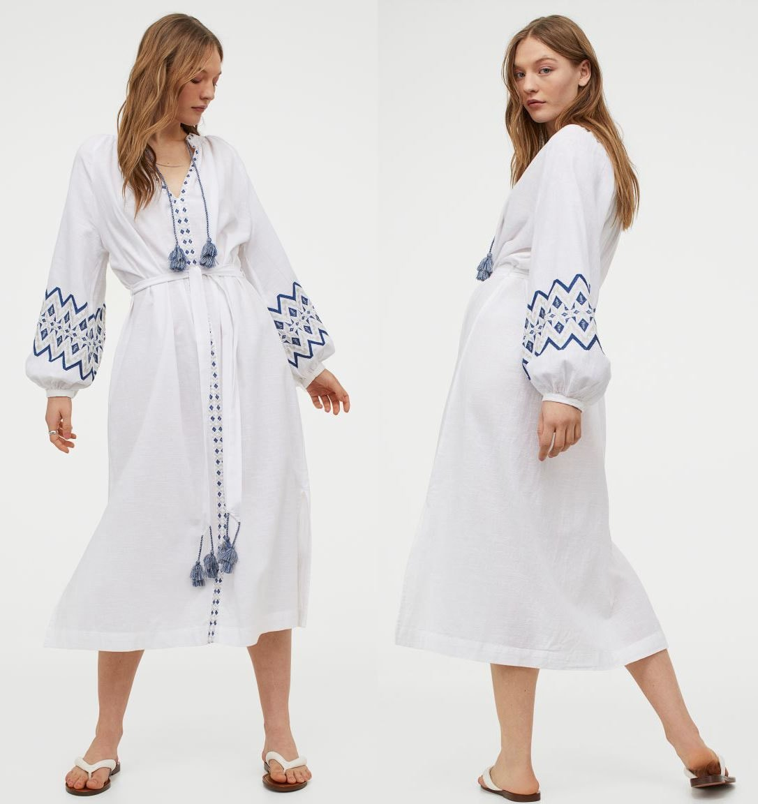 A lightweight kaftan dress made from woven cotton fabric with embroideries, tassels, and raglan balloon sleeves